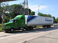 CFI/Con-Way truck damaged by low-clearance underpass